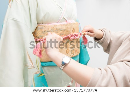 Woman in a kimono(The girls prepare a kimono known as furisode for their coming of age ceremony.) Royalty-Free Stock Photo #1391790794