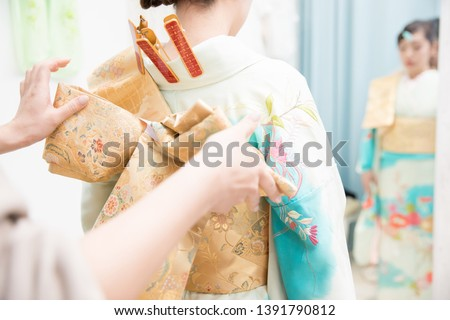 Woman in a kimono(The girls prepare a kimono known as furisode for their coming of age ceremony.) Royalty-Free Stock Photo #1391790812