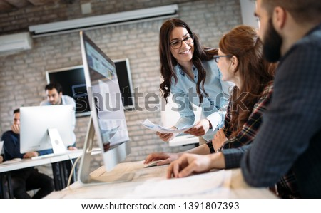 Young architects working on project in office #1391807393
