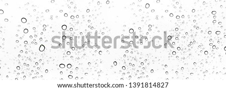 Rain drops on window glasses surface Natural Pattern of raindrops. Natural pattern of raindrops on white background for your design. #1391814827
