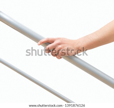 Cropped shot of an unrecognizable man hand resting on a railing isolated on a white background #1391876126