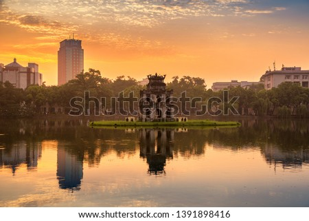 Hoan Kiem Lake (Lake of the Returned Sword) and the Turtle Tower in Hanoi , Vietnam #1391898416