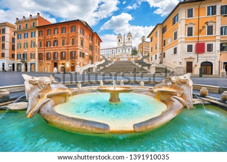 Rome, Italy. Fountain of the Boat (Fontana della Barcaccia) on Spanish square (Piazza di Spagna) at the bottom of Spanish stairs famous landmark design by Bernini. Summer day and blue sky with clouds. #1391910035