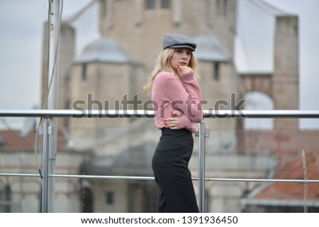 portrait of blonde girl wearing pink sweater and grey hat in the cafe #1391936450
