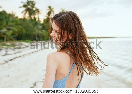 woman in swimsuit on the beach ocean                              #1392005363