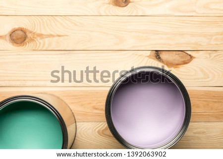 top view of tins with paints on wooden surface #1392063902