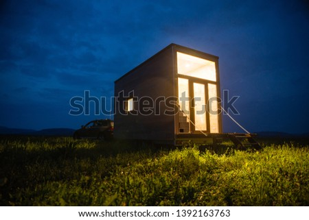 Mobile tiny house. Great for outdoor experiences and wildlife. Lots of mobility and pure adventure. No need for special authorizations, only a decent car to pull this tiny house and off you go. Royalty-Free Stock Photo #1392163763