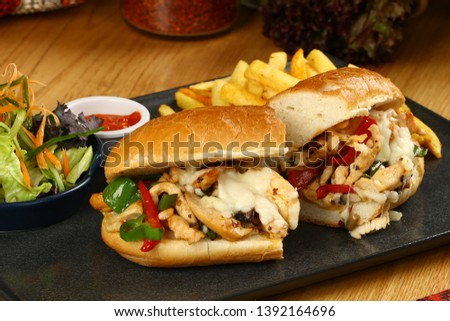 Submarine baguette chicken sandwich with melted cheese, vegetable and french fries #1392164696