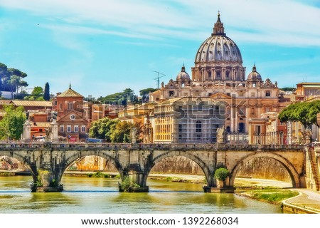 The Papal Basilica of St. Peter in the Vatican (St. Peter's Basilica), an Italian Renaissance church in Vatican City, the papal enclave within city of Rome, view from Tiber river on Ponte Sant'Angelo #1392268034