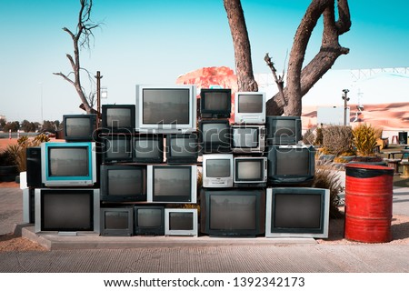 Pile of old televisions displayed along the road #1392342173