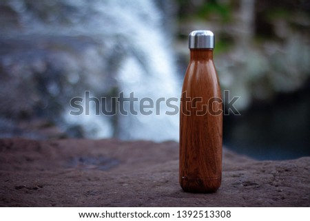 A metal drinking bottle with natural background.  #1392513308