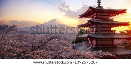 Fujiyoshida, Japan Beautiful view of mountain Fuji and Chureito pagoda at sunset, japan in the spring with cherry blossoms #1392575207