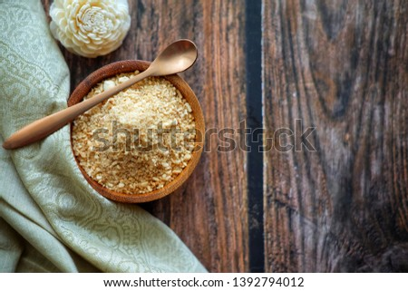 "Close up of Southern Thai desserts. Thai call ""Kanom kee mood"" The main ingredients are roasted rice, roasted coconut, sugar and salt. #1392794012"