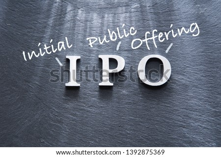 IPO abbreviation by wood letters on wood background, IPO is Initial Public Offering #1392875369