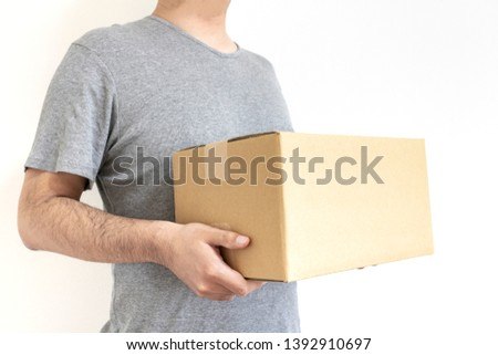 Standing man with cardboard box #1392910697