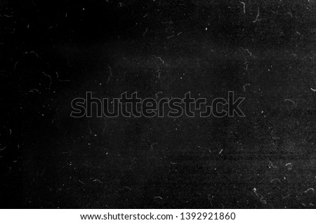 Black grunge scratched background, old film effect, dusty scary texture #1392921860