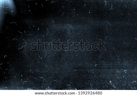 Dark blue grunge scratched background, old film effect, distressed scary dusty texture