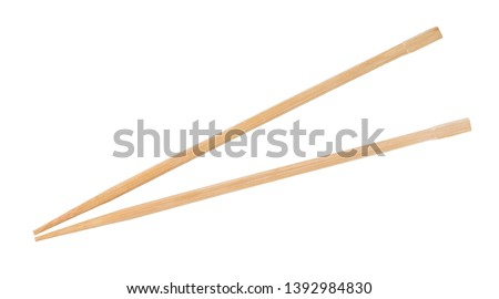 disposable beech wooden chopsticks isolated on white background #1392984830