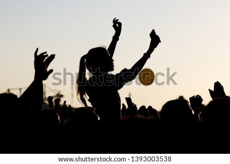 Silhouette of girl at Outdoors Music Festival Royalty-Free Stock Photo #1393003538