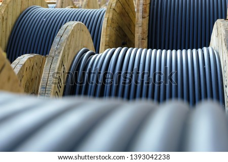 Wooden Coils Of Electric Cable Outdoor. High and low voltage cables in the storage. #1393042238