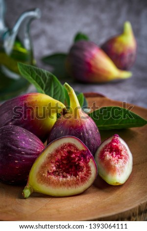 Fresh ripe figs on dark table. Healthy mediterranean fig fruit. Fresh figs on black background. Beautiful blue violet figs with empty copyspace close up #1393064111