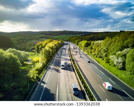 Highway in Germany with cars and sky with big clouds #1393362038