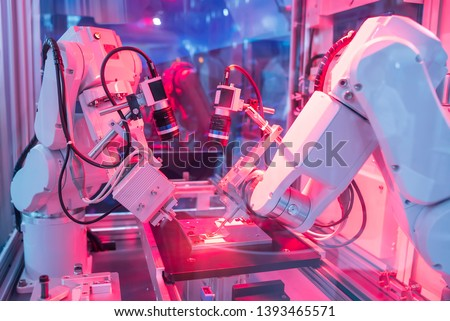 robotic arm catch for electronic assembly line. The robot for smart technology manufacturing process. #1393465571