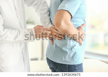 Urologist examining male patient in clinic #1393634675