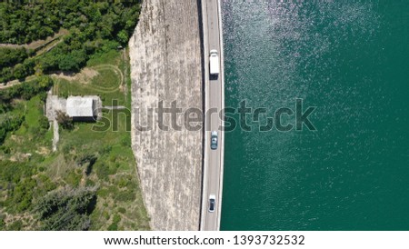 Aerial drone top down photo of famous lake and dam of Marathon or Marathonas with beautiful clouds and blue sky, North Attica, Greece