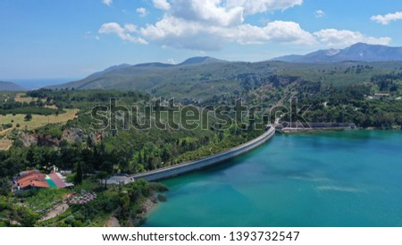 Aerial drone photo of famous lake and dam of Marathon or Marathonas with beautiful clouds and blue sky, North Attica, Greece