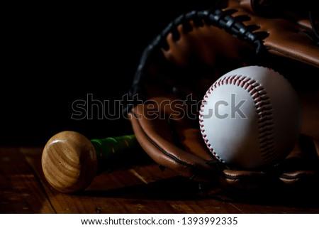 Baseball equipment, baseball and white with a dark background #1393992335