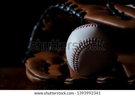 Baseball equipment, baseball and white with a dark background #1393992341