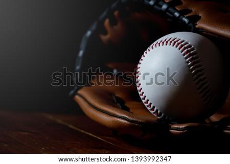Baseball equipment, baseball and white with a dark background #1393992347
