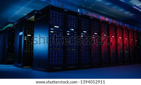 Shot of Data Center With Multiple Rows of Fully Operational Server Racks. Modern Telecommunications, Artificial Intelligence, Supercomputer Technology Concept. Shot in Dark with Neon Blue, Pink Lights #1394052911