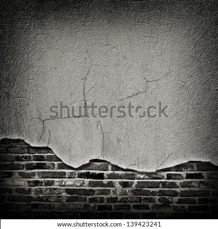 Grey cracked rough plaster coming off the brick wall - old vintage or grungy industrial background