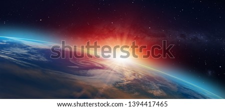 """Planet Earth with a spectacular sunset """"Elements of this image furnished by NASA"""" Royalty-Free Stock Photo #1394417465"""