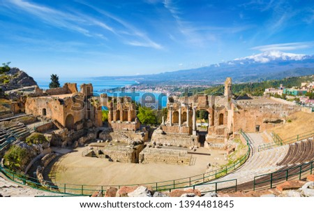 Ruins of Ancient Greek theatre in Taormina on background of Etna Volcano, Italy. Taormina located in Metropolitan City of Messina, on east coast of island of Sicily. #1394481845