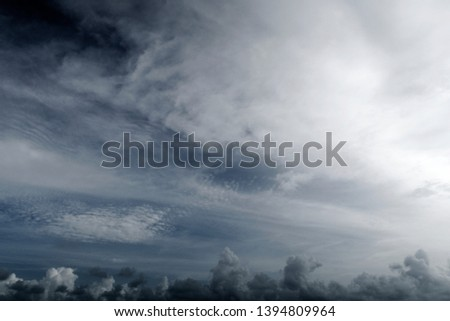 Wide angle view of Dark & dramatic storm clouds before thunderstorm in dark cloudy sky background, rainy season concept, copy space. Abstract nature background of unpredictable weather of tropical sky