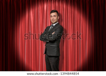 Young smiling businessman on red stage curtains background. Digital art. Fame and glory. Business and commerce. #1394844854