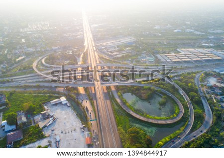Bangkok Expressway top view, Top view over the highway,expressway and motorway at night, Aerial view interchange of a city, Shot from drone, Expressway is an important infrastructure in Thailand #1394844917