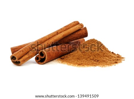 Cinnamon sticks and powder on white background Royalty-Free Stock Photo #139491509