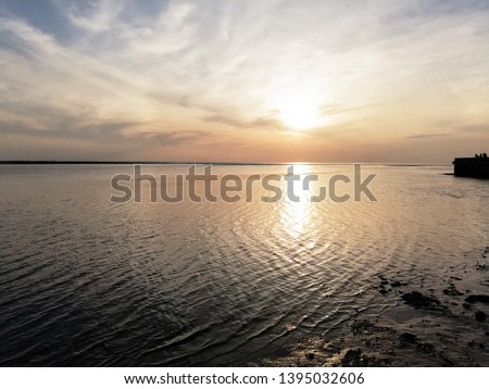Beautiful sunset with clouds under the river #1395032606