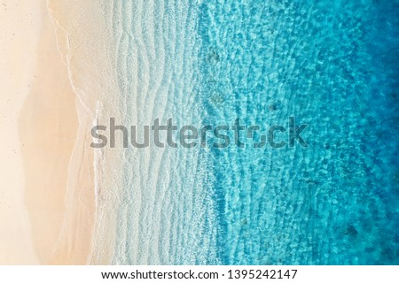 Beach and ocean as a background from top view. Azure water background from top view. Summer seascape from air. Gili Meno island, Indonesia. Travel - image Royalty-Free Stock Photo #1395242147