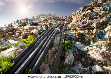 huge landfill site, a special device collects and pumps methane and other gases into storage. Gas through rubber pipes goes to tanks, alternative energy #1395293246