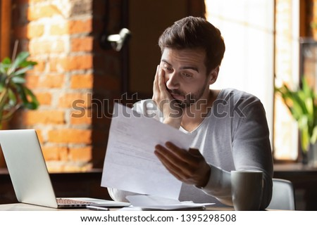 Confused frustrated young man reading letter in cafe, debt notification, bad financial report, money problem, money problem, upset student receiving bad news, unsuccessful exam or test results #1395298508