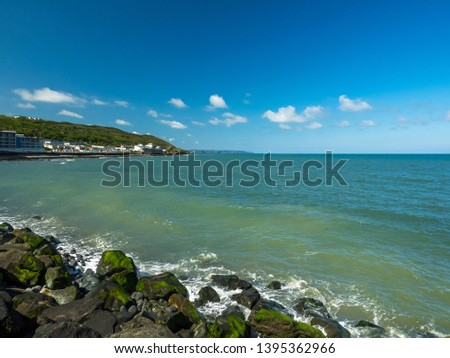 Westward Ho! waterfront at high tide on the North Devon coast of England Royalty-Free Stock Photo #1395362966