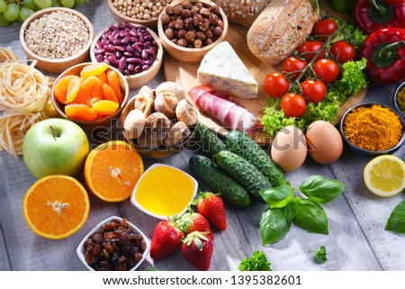 Composition with assorted organic food products on wooden kitchen table. #1395382601