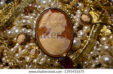 A photo of a an antique carved lady cameo with pearls gold,  #1395431675