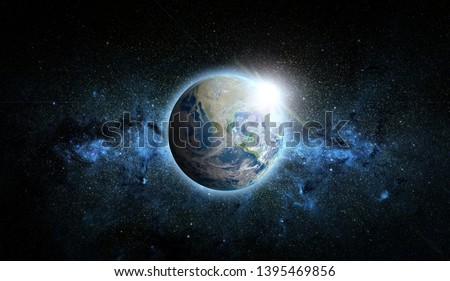 Planet Earth with sunrise on space background. Elements of this image furnished by NASA. #1395469856