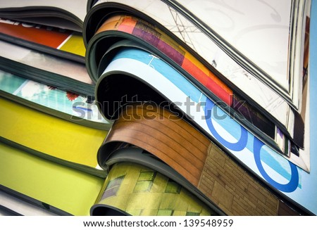 a pile of magazines close up Royalty-Free Stock Photo #139548959